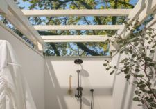 Room outdoor shower with tree and sky view